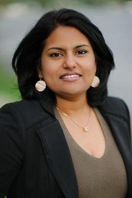 Dr. Asha Madhavan smiling.